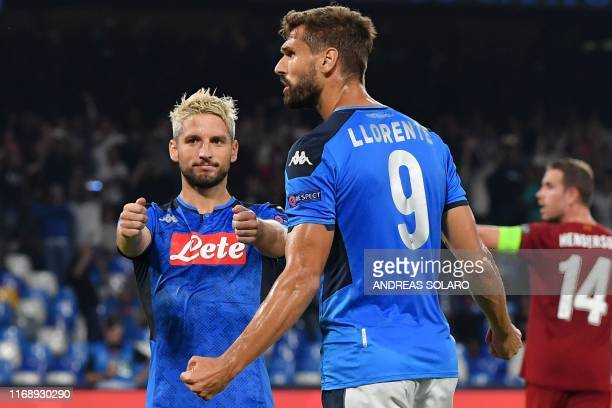 Napoli's Belgian forward Dries Mertens celebrates with Napoli's Spanish forward Fernando Llorente after scoring a penalty during the UEFA Champions...
