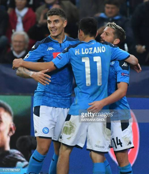 Napoli's Belgian forward Dries Mertens celebrates with team mates scoring the 1-2 during the UEFA Champions League Group E football match FC Red Bull...