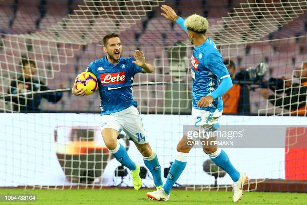 Napoli's Belgian forward Dries Mertens celebrates with teammate Napoli's French defender Kevin Malcuit after scoring a goal during the Italian Serie...