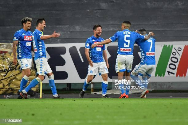 Napoli's Belgian forward Dries Mertens celebrates with teammates after scoring a goal during the Italian Serie A football match Napoli vs Inter Milan...