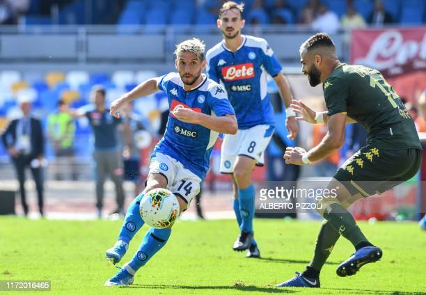 Napoli's Belgian forward Dries Mertens challenges Brescia's Venezuelan defender Jhon Chancellor during the Italian Serie A football match Napoli vs...
