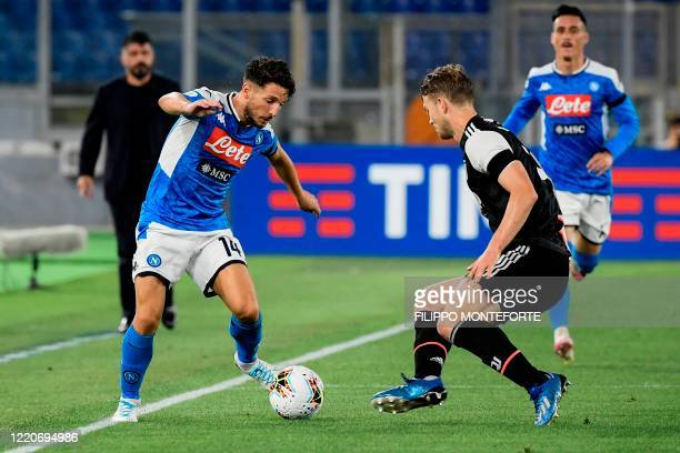 Napoli's Belgian forward Dries Mertens challenges Juventus' Dutch defender Matthijs de Ligt during the TIM Italian Cup final football match Napoli vs...