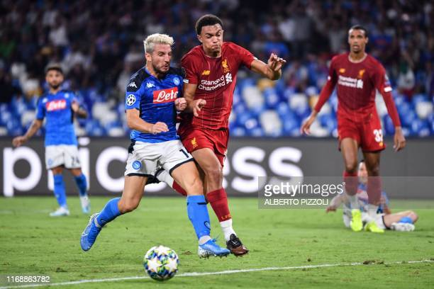 Napoli's Belgian forward Dries Mertens challenges Liverpool's English defender Trent AlexanderArnold during the UEFA Champions League Group E...