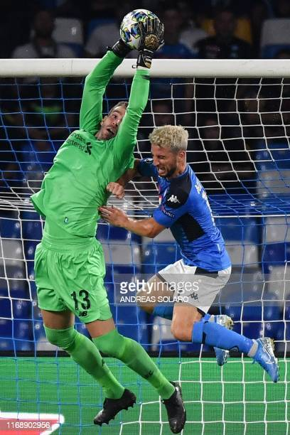 Napoli's Belgian forward Dries Mertens challenges Liverpool's Spanish goalkeeper Adrian during the UEFA Champions League Group E football match...