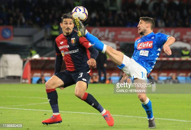 Napoli's Belgian forward Dries Mertens controls the ball ahead of Genoa's German defender Koray Gunter during the Italian Serie A football match...
