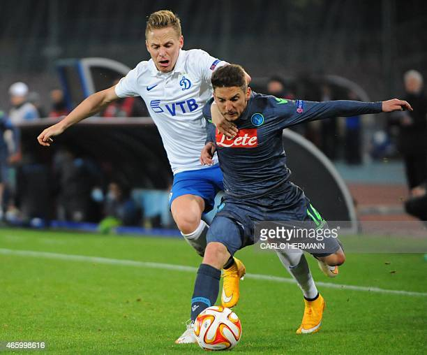 Napoli's Belgian forward Dries Mertens fights for the ball with Dinamo Moscow's Hungarian midfielder Balazs Dzsudzsak during the UEFA Europa League...