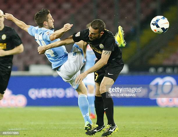 Napoli's Belgian forward Dries Mertens fights for the ball with Verona's Italian defender Alessandro Agostini during the Italian Serie A football...
