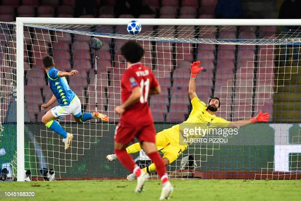 Napoli's Belgian forward Dries Mertens hits the crossbar as Liverpool's Brazilian goalkeeper Alisson dives during the UEFA Champions League group C...