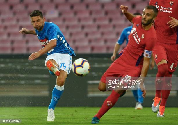 Napoli's Belgian forward Dries Mertens kicks the ball despite Fiorentina's Argentine defender German Pezzela during the Italian Serie A football...