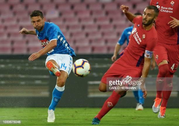 Napoli's Belgian forward Dries Mertens kicks the ball despite Fiorentina's Argentine defender German Pezzela during the Italian Serie A football...