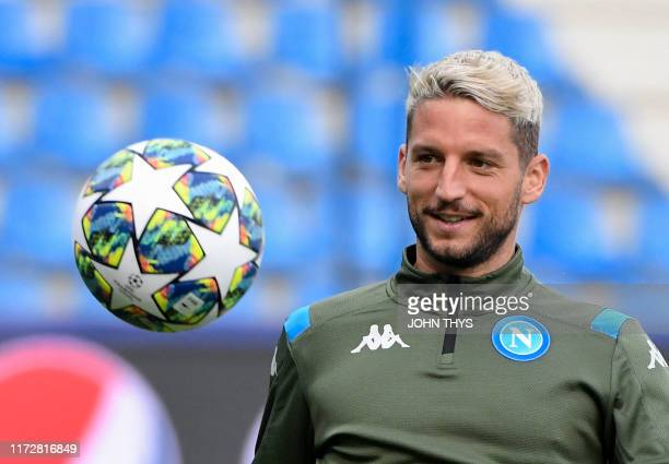 Napoli's Belgian forward Dries Mertens looks at the ball during a training session at the Fenix Stadium in Genk on October 1 2019 on the eve of the...