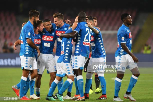 Napoli's Belgian forward Dries Mertens Napoli's Polish forward Arkadiusz Milik and teammates celebrate after winning the Italian Serie A football...