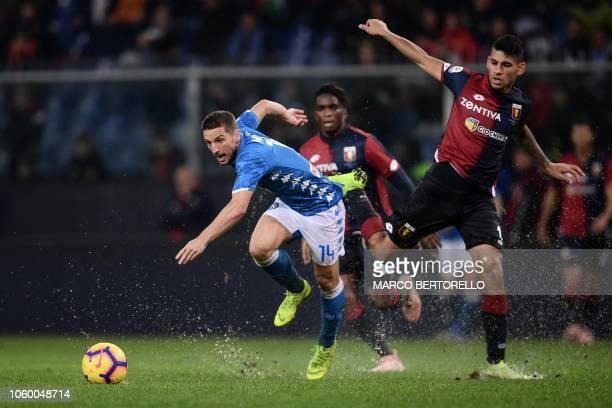 Napoli's Belgian forward Dries Mertens outruns Genoa's Argentine defender Cristian Romero during the Italian Serie A football match Genoa vs Napoli...