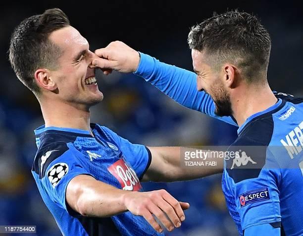 Napoli's Belgian forward Dries Mertens pinches Napoli's Polish forward Arkadiusz Milik's nose after Milik scored his third goal during the UEFA...