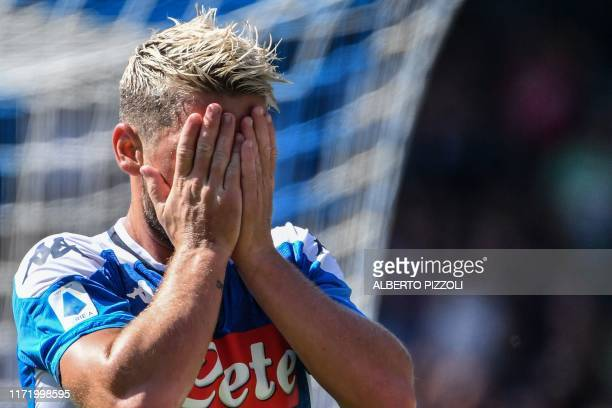 Napoli's Belgian forward Dries Mertens reacts after missing a goal opportunity during the Italian Serie A football match Napoli vs Brescia on...