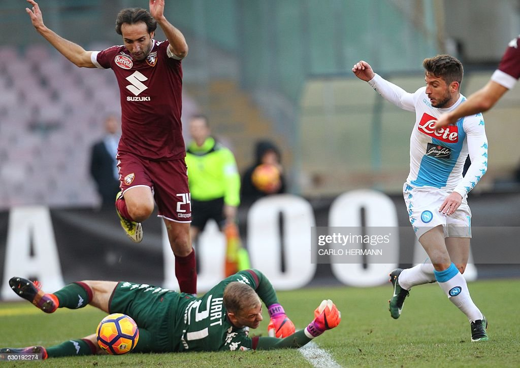 Napoli's Belgian forward Dries Mertens (R) scores a goal despite Torino's British goalkeeper Joe Hart (Bottom) and Italian defender Emiliano Moretti during an Italian Serie A football match between SSC Napoli and Torino FC on December 18, 2016 at the San Paolo Stadium in Naples. / AFP / CARLO