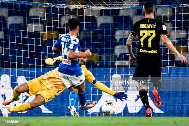 Napoli's Belgian forward Dries Mertens scores an equalizer past Inter Milan's Slovenian goalkeeper Samir Handanovic during the Italian Cup semifinal...