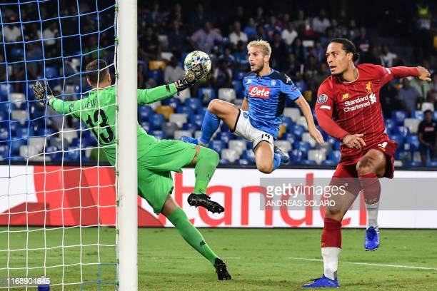 Napoli's Belgian forward Dries Mertens shoots on goal despite Liverpool's Dutch defender Virgil van Dijk during the UEFA Champions League Group E...