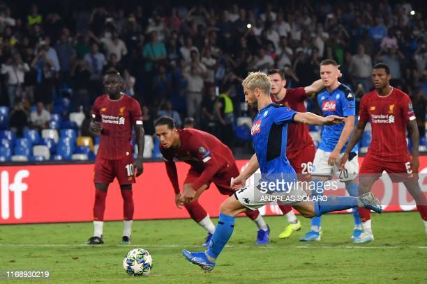 Napoli's Belgian forward Dries Mertens shoots to score a penalty during the UEFA Champions League Group E football match Napoli vs Liverpool on...