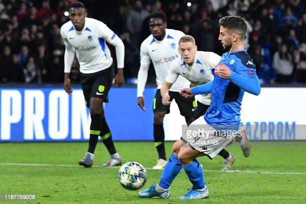 Napoli's Belgian forward Dries Mertens shoots to score a penalty during the UEFA Champions League Group E football match Napoli vs Genk on December...