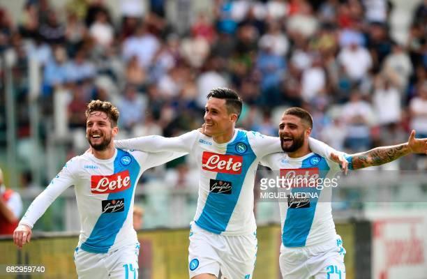 Napoli's Belgian striker Dries and Napoli's Italian striker Lorenzo Insigne congratulate Napoli's Spanish striker Jose Maria Callejon after scoring...