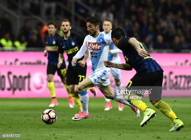 Napoli's Belgian striker Dries Mertens advances with the ball past Inter Milan's Chilean midfielder Gary Medel during the Italian Serie A football...