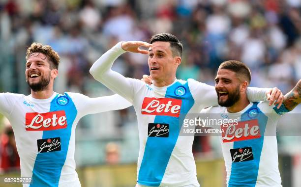 Napoli's Belgian striker Dries Mertens and Napoli's Italian striker Lorenzo Insigne congratulate Napoli's Spanish striker Jose Maria Callejon after...