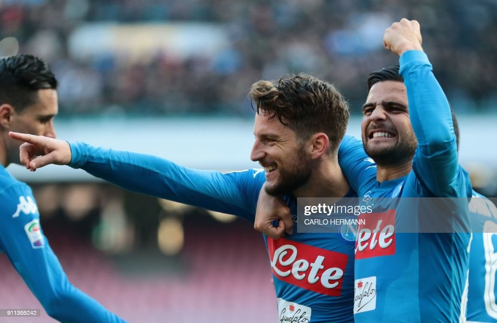 Napoli's Belgian striker Dries Mertens (C) celebrates with teammate Napoli's striker Lorenzo Insigne (R) after scoring a penalty during the Italian Serie A football match SSC Napoli vs Bologna FC 1909 on Jaunary 28, 2018 at the San Paolo Stadium. /