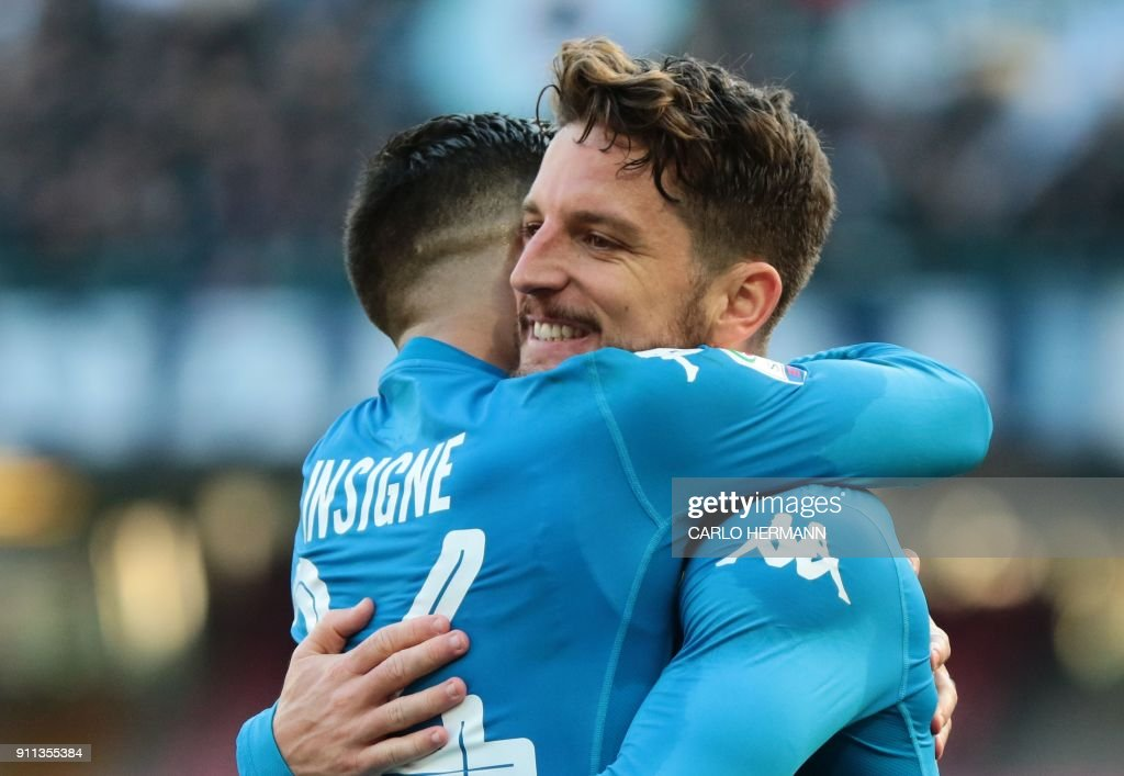 Napoli's Belgian striker Dries Mertens (R) celebrates with teammate Napoli's striker Lorenzo Insigne after scoring a penalty during the Italian Serie A football match SSC Napoli vs Bologna FC 1909 on Jaunary 28, 2018 at the San Paolo Stadium. /