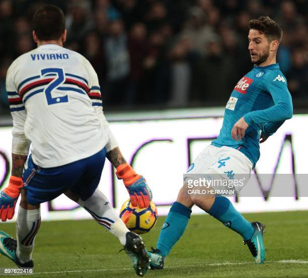 Napoli's Belgian striker Dries Mertens fights for the ball with Sampdoria's goalkeeper from Italy Emiliano Viviano during the Italian Serie A...