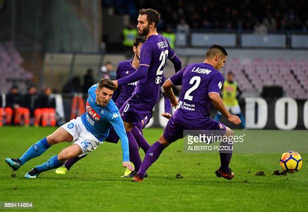 Napoli's Belgian striker Dries Mertens fights for the ball with Fiorentina's Argentinian defender German Pezzella and Fiorentina's defender Vincent...
