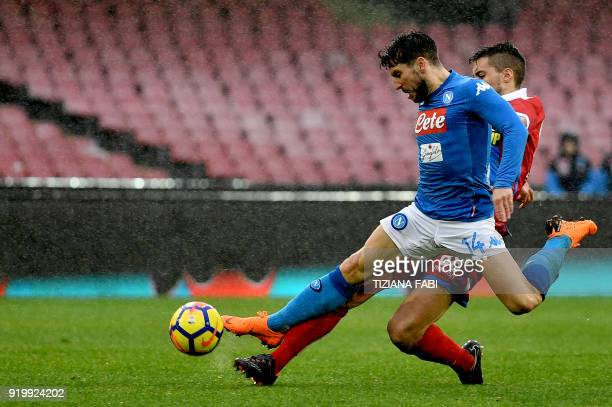 Napoli's Belgian striker Dries Mertens fights for the ball with Spal's Italian midfielder Alberto Grassi during the Serie A football match between...