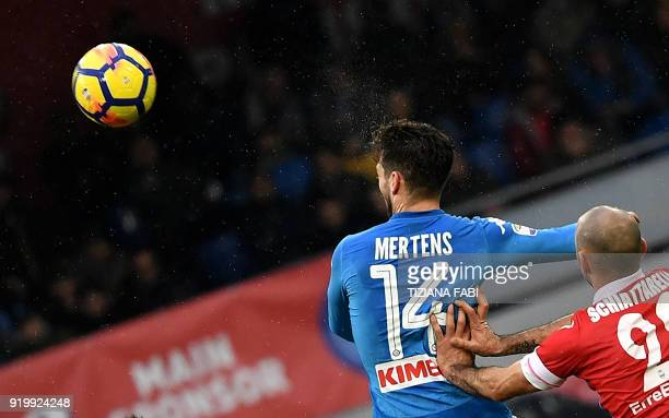 Napoli's Belgian striker Dries Mertens fights for the ball with Spal's Italian midfielder Pasquale Schiattarella during the Serie A football match...