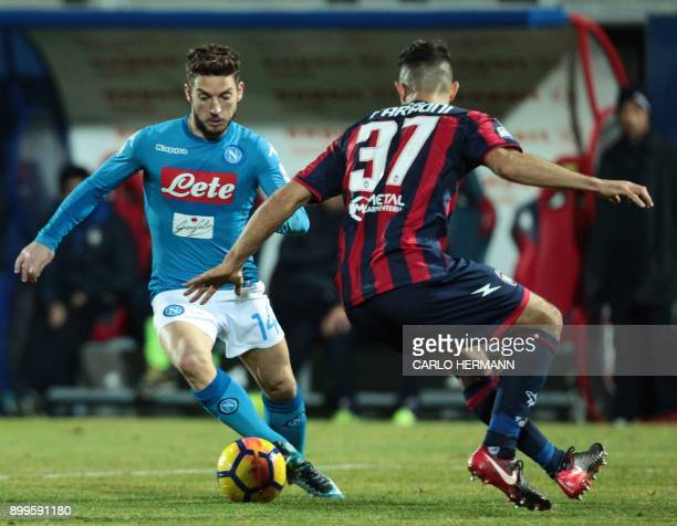 Napoli's Belgian striker Dries Mertens vies for the ball with Crotone's Italian defender Davide Faraoni during the Italian Serie A football match FC...