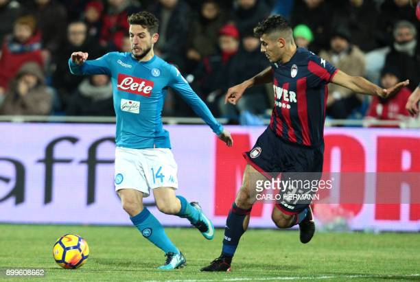 Napoli's Belgian striker Dries Mertens vies with Crotone's Italian defender Davide Faraoni during the Italian Serie A football match FC Crotone vs...