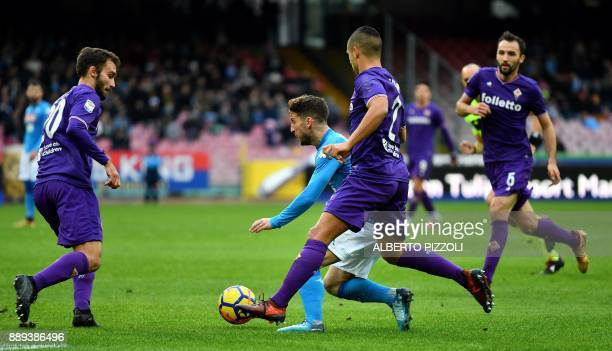 Napoli's Belgian striker Dries Mertens vies with Fiorentina's Argentinian defender German Pezzella and defender Vincent Laurini during the Italian...