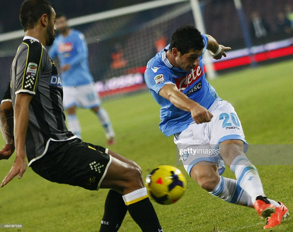 SSC Napoli's Blerim Dzemaili (R) vies with Udinese's Brazilian defender Gabriel Silva during the Italian Serie A football match SSC Napoli vs Udinese at the San Paolo Stadium in Naples on December 7, 2013.