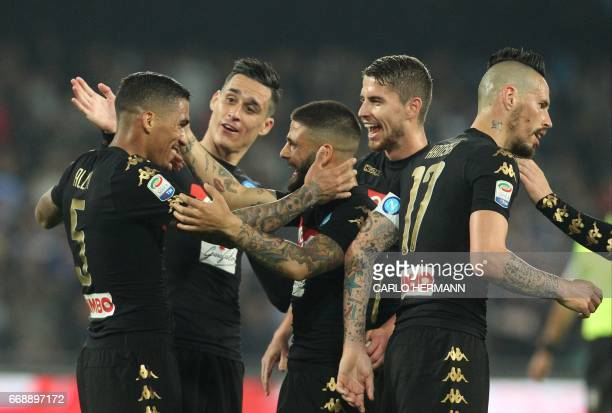 Napoli's Brazilian midfielder Allan celebrates with teammate after scoring during the Italian Serie A football match SSC Napoli vs Udinese Calcio on...