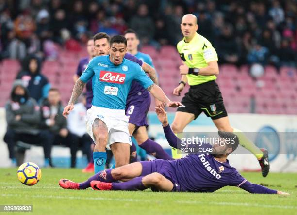 STADIUM NAPLES CAMPANIA ITALY Napoli's Brazilian midfielder Allan fights for the ball with Fiorentina's Italian midfielder Marco Benassi during the...