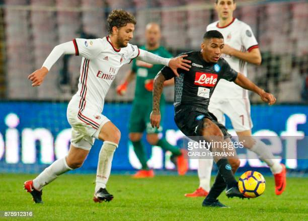 Napoli's Brazilian midfielder Allan fights for the ball with Milan's Italian midfielder Manuel Locatelli during the Italian Serie A football match...