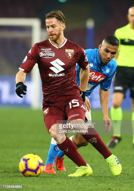 Napoli's Brazilian midfielder Allan fights for the ball with Torino's defender from Argentina Cristian Ansaldi during the Italian Serie A football...