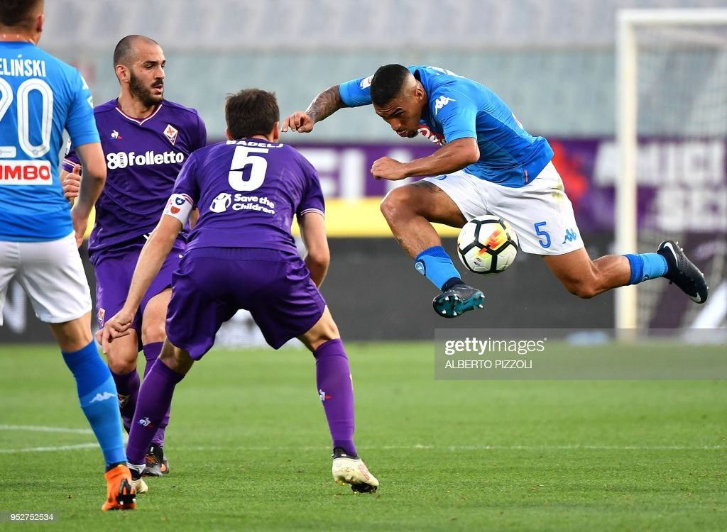 Napoli's Brazilian midfielder Allan (R) jump kicks the ball during the Italian Serie A football match Fiorentina vs Napoli on April 29, 2018 at Artemio-Franchi stadium in Florence.