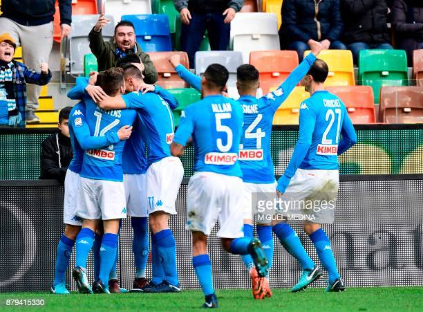 Napoli's Brazilian midfielder Jorginho celebrates with teammates after scoring during the Italian Serie A football match Udinese vs Napoli at the...