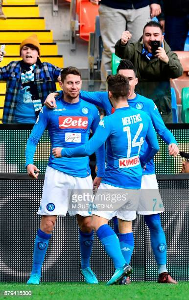 Napoli's Brazilian midfielder Jorginho celebrates with teammates Napoli's forward from Belgium Dries Mertens and Napoli's midfielder from Spain Jose...