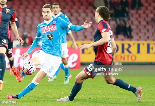 Napoli's Brazilian midfielder Jorginho fights for the ball with Genoa's Uruguayan midfielder Diego Laxalt during the Italian Serie A football match...