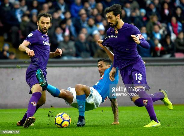 TOPSHOT Napoli's Brazilian midfielder Marques Loureiro Allan fights for the ball with Fiorentina's Italian defender Davide Astori and Fiorentina's...