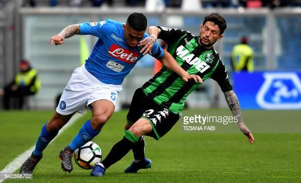 Napoli's Brazilian midfielder Marques Loureiro Allan fights for the ball with Sassuolo's midfielder Stefano Sensi during the Italian Serie A football...