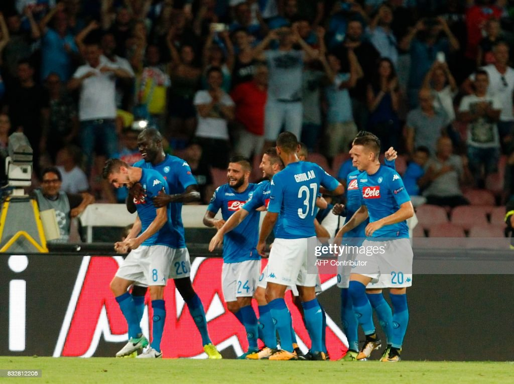 Napoli's Brazilian-born midfielder Jorginho (L) celebrates with teammates after scoring a penalty during the UEFA Champions League Play Off first leg football match SSC Napoli vs OCG Nice, on August 16 2017 at the San Paolo Stadium. /