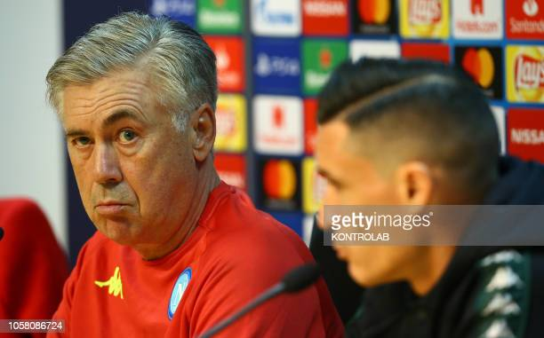 Napoli's coach from Italy Carlo Ancelotti addresses to media next to Napoli's striker from Spain Jose Maria Callejon during a press conference on the...