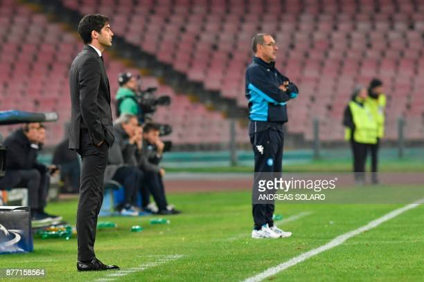 Napoli's coach from Italy Maurizio Sarri and Shakhtar Donetsk's Portuguese manager Paulo Fonseca follow the game during the UEFA Champions League...